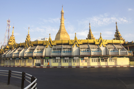 Yangon, Myanmar-May 8th 2014: Sule Pagoda bathed in early morning sunshine. The pagoda is considered to be the centre of Yangon from where distances to other places are measured. 에디토리얼