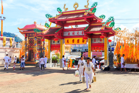 Phuket, Thailand - October 13th 2015: Devotees enter the Jui Tui shrine during the vegetarian festival. The festival is an annual event. Sajtókép