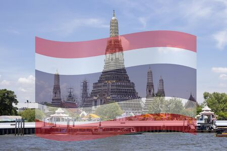 Wat Arun a.k. The Temple of Dawn, Bangkok, Thailand with Thai flag superimposed. Digital composite image