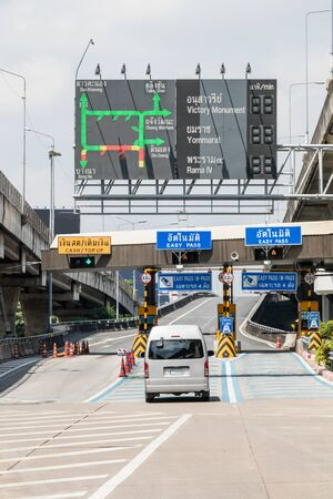 Cars passing through highway toll booths, Bangkok, Thailand