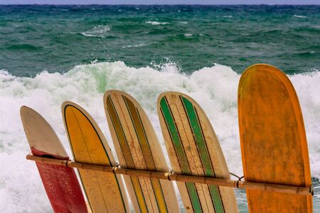 Surfboards against a rough sea background