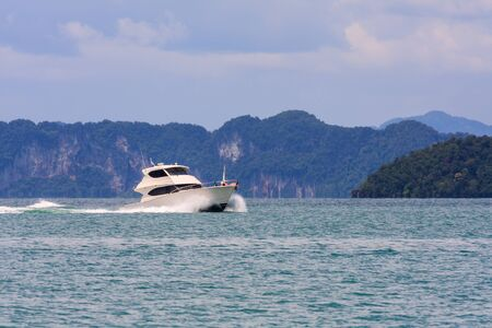 Motorboat cruising in Phang Nga Bay, Thailand on a sunny day