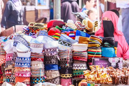 Marrakech, Morocco - September 9th 2010: Woman selling hats in the souk. The city is a popular tourist destination Stock Photo