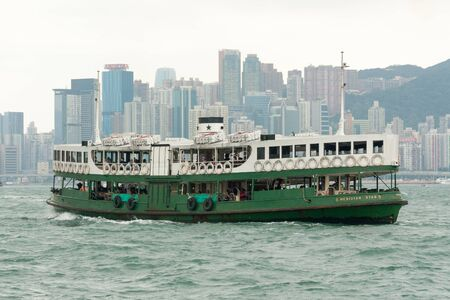 Hong Kong, China - October 10th 2009: The Meridian Star ferry crossing Victoria harbour. The ferry runs between Hong KOng island and Kowloon.
