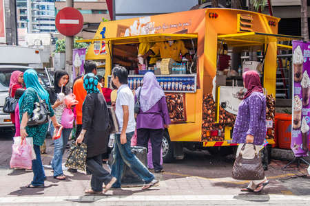 Kuala Lumpur, Malaysia - 6th June 2010: Shoppers and customers around a drinks truck. The use of food trucks is growing.