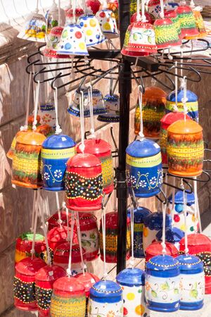 Pottery souvenirs hanging outside a shop in Mijas, Andalucia, Spain