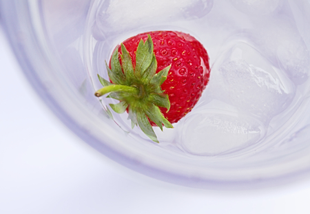 ice water: strawberry in water with ice
