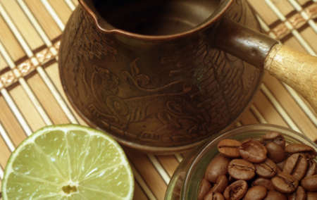 Composition from natural materials.To make coffee.Still life composition on coffee theme.Coffee grains on a table.Coffee little table with a wooden cloth.Coffee plus lemon.