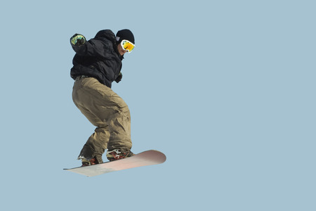 Jumping snowboarder isolated Stock Photo