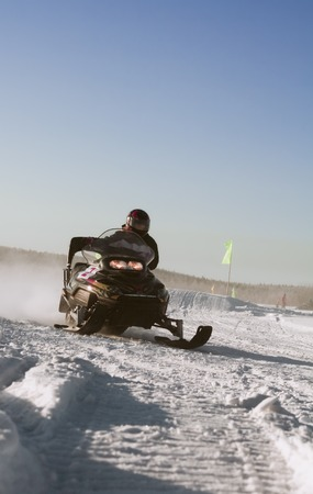 The woman is snowmobile racer.