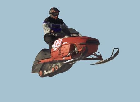 Snowmobile racing isolated