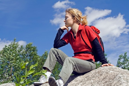 Girl reposes on the stone. Stock Photo