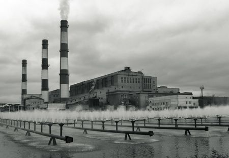 Group of industrial buildings and fountains.Tritone image. Stock Photo