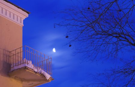 Old building with a balcony in the night Stock Photo