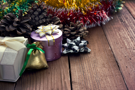 Christmas decorations and gifts on wooden background