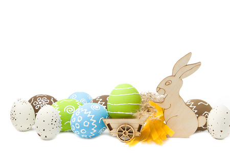 Easter rabbit with eggs in cart isolated on white background