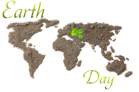 Earth Day. Concept ecology. World map, globe from the soil with green plants around the world isolated on white background Stock Photo