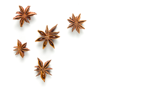Star anise, scattered in a chaotic manner, isolated on white background Stock Photo