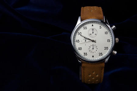 wrist strap: Mens wrist watch with brown leather strap closeup on a dark blue background with place for your text Stock Photo