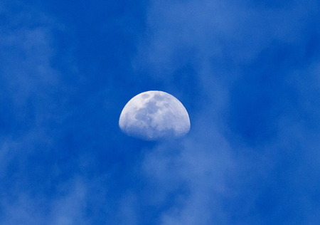 Moon and clouds at an early evening photo