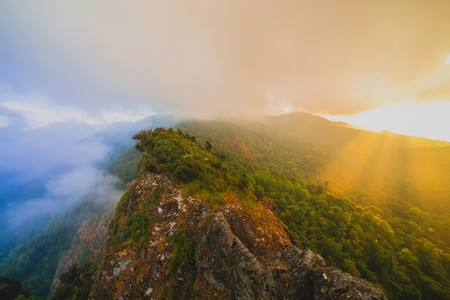 highlands region: Shining light through a dark sky over mountain