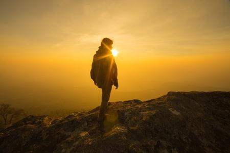 silhouette man walking into sunset sky Stok Fotoğraf