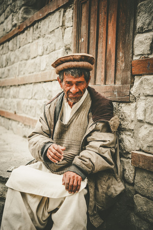 hardworker: Old Man in a village in the south of Skardu, Pakistan Editorial