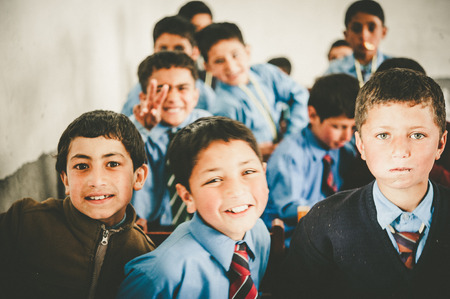 elementary age boys: Children in a village in the south of Skardu are learning in the classroom of the village school