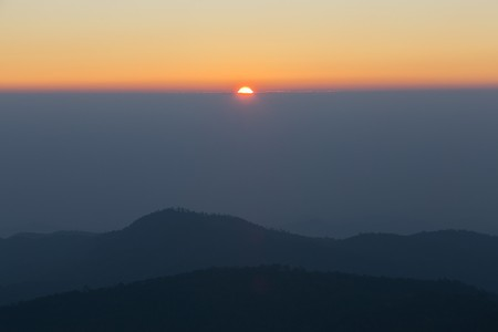 faintly visible: Sunset in the mountain