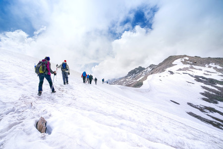 climbers climbing mountain with snow field Stok Fotoğraf