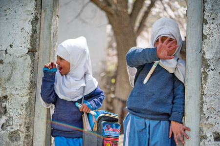 muslim baby girl: SKARDU, PAKISTAN - APRIL 18: An unidentified Children in a village in the south of Skardu are learning in the classroom of the village school April 18, 2015 in Skardu, Pakistan