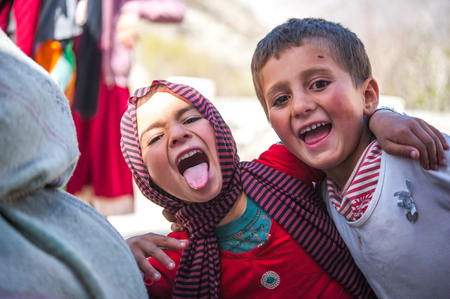 HUNZA, PAKISTAN - APRIL 14: An unidentified Children in a village of the Hunza, April 14, 2014 in Hunza, Pakistan with a population of more than 150 million people. Editöryel