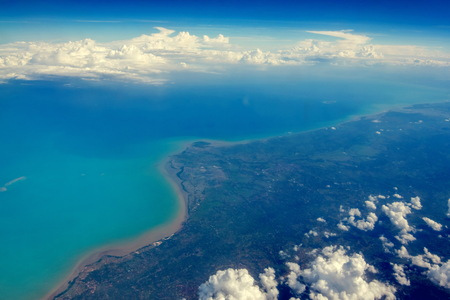 arial view: View of cloudscape and airplane wing during air travel Stock Photo