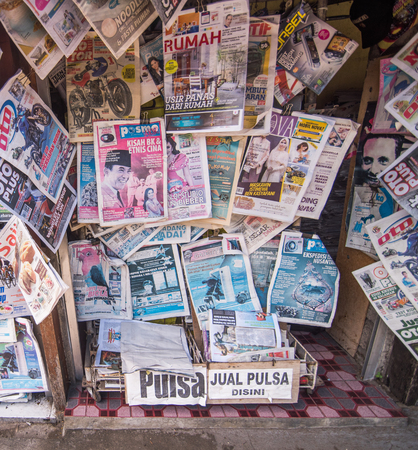 state owned: KUTA,  BALI, INDONESIA-AUGUST 16  :A newsstand with many daily newspapers on the sidewalk of a street in KUTA capital. Indonesia has more than 600 state owned newspapers and media agencies. Editorial