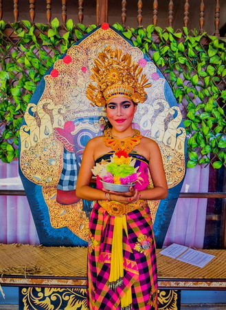 BATUBULAN, BALI, INDONESIA-AUGUST 13 : Unidentified woman posing for tourists at the weekly Barong Dance, the traditional balinese performance on August 13, 2016 in Batubulan, Bali, Indonesia.