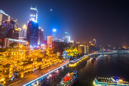 Chongqing, China nighttime cityscape in the Jiefangbei District.