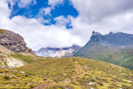 hiker hiking in Yading national level reserve in Daocheng, Sichuan Province, China. Stock Photo