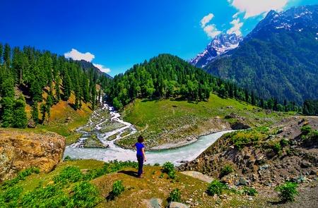 Asian traveler enjoying mountain view in Ladakh, Jammu & Kashmir state, northern India.