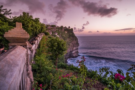 Scenic landscape of fantastic sunset at Uluwatu Bali. Travel Bali, Indonesia. Tranquility of sunset in Bali. Sunset at Uluwatu cliff, Bali, Indonesia. Bali landmark sunset. Bali sunset. Explore Bali Foto de archivo