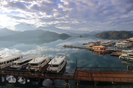 View of Sun Moon Lake with the passenger boats waiting at the numerous piers. Stok Fotoğraf