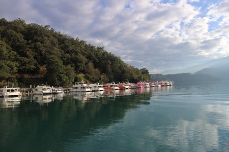 Sun Moon Lake Yuchi Nantou county Taiwan - December 09 2018 : View of Sun Moon Lake with the passenger boats waiting at the numerous piers. Stock Photo