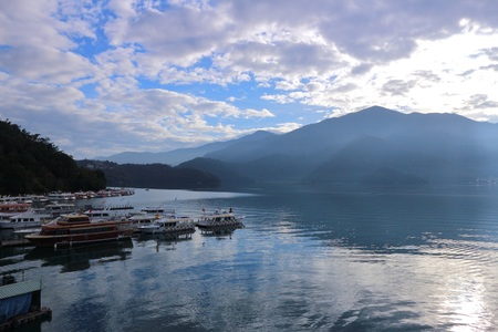 View of Sun Moon Lake with the passenger boats waiting at the numerous piers. Stock Photo