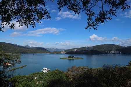 Boats on the lake with landscape of beautiful mountain view at Sun Moon Lake, Nantou city, Taiwan