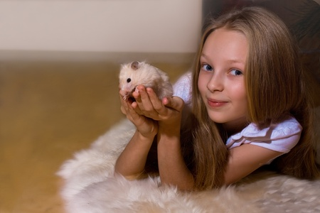attachments: Portrait of a happy young girl with her pet