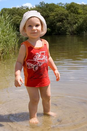 barefooted: 1,5 years old barefooted  boy on the river-bank