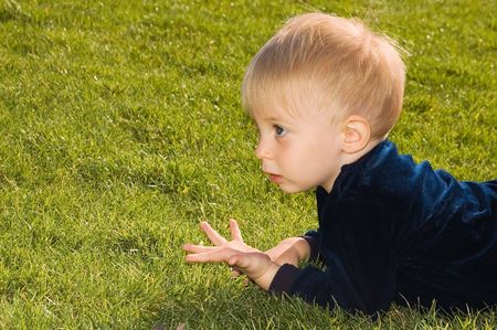 grassplot:  boy is lying on the grass-plot