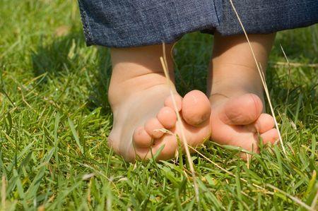 baby's feet: babys feet on a green grass