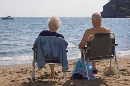 gaffer: elderly couple rest on the beach