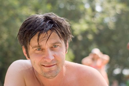 smiling man after swimming photo