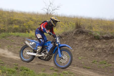 supercross: young rider in a cross-country motorcycle race